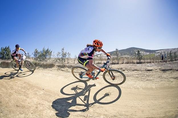 Elisabeth Brandau and Hielke Elferink riding together (Mark Sampson/Cape Epic/Sportzpics)