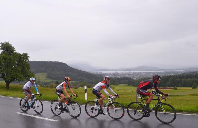 The four-man breakaway riding through the rain (фото: Tim de Waele/TDWSport.com)